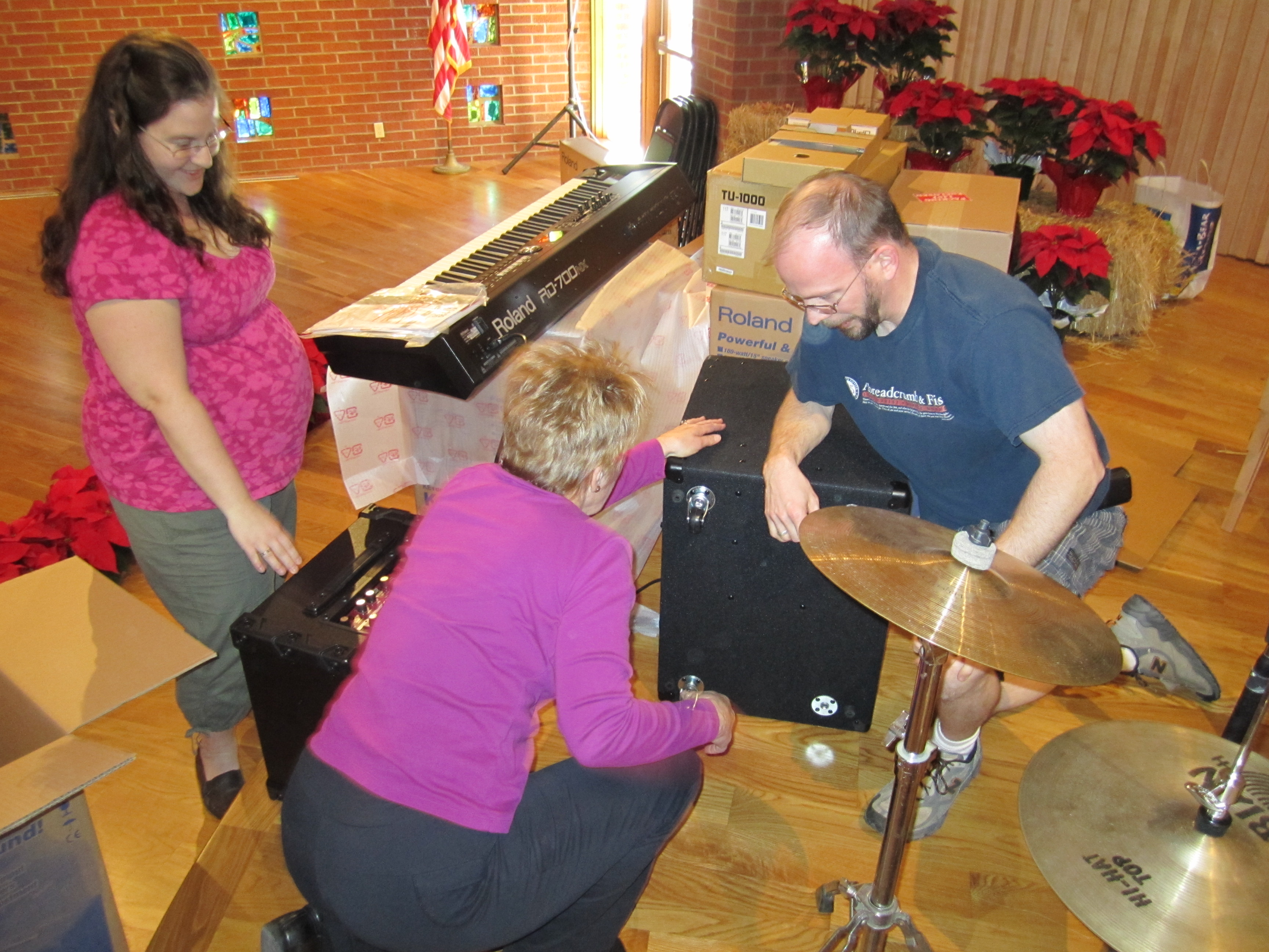 Pastors Lindsey (left) and Robbie (right) Carnes unpacking the new Roland band equipment