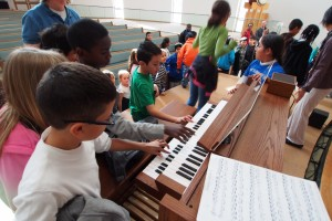"Students get ""hands on"" with the Roland C-330 Classic organ."